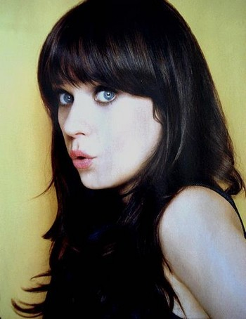A girl with black hair and blue eyes